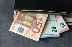 Cash, euro. Black leather wallet with money euro Royalty Free Stock Images