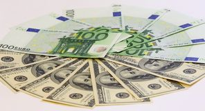 Cash, euro and dollar. Cash, pie made of euro and dollars royalty free stock photos
