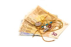 Cash euro for gold. Scrap of gold. Old and broken jewelry on a background of Euro banknotes stock photo