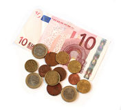 Cash euros coins and Banknotes on white Royalty Free Stock Photos