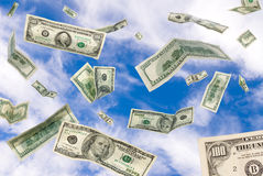 Cash falling from the sky royalty free stock image