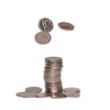 Cash Float. Twenty pence coins appear to float above a stack of other coins, all isolated against a white background royalty free stock photography