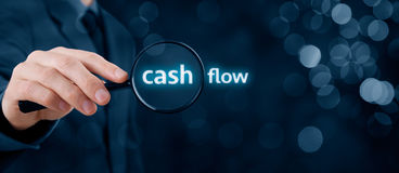 Cash flow audit. Focus on cash flow and audit of accounts concept. Businessman (auditor) analyze cash flow. Wide banner composition with bokeh in background stock images