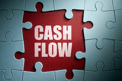 Cash flow solution. Missing pieces from a jigsaw puzzle revealing cash flow Stock Images