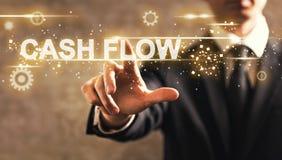 Cash Flow text with businessman. On dark vintage background stock image