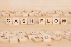 Cash Flow word written on wood Royalty Free Stock Photography