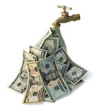 Cash Flowing. A brass faucet with cash flowing out of it royalty free stock image