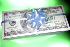 Cash gift. Lots of cash with bow on top royalty free stock images