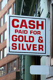 Cash for gold. Cash paid for gold and silver jewellery royalty free stock photos