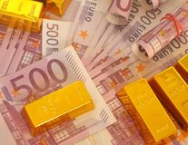 Cash and gold. Gold bars with 500 euro banknotes stock photography