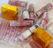 Cash and gold. Gold bars with 500 euro banknotes royalty free stock images