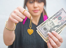 Cash for gold. Woman demonstrating. Stock Image