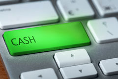 Cash. Green button cash on keyboard royalty free stock photo