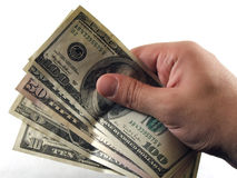 Cash in hand. Hand holding dollar bills Royalty Free Stock Photography