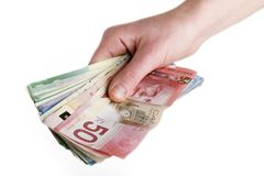 Cash in Hand. A hand full of Canadian Cash stock photography