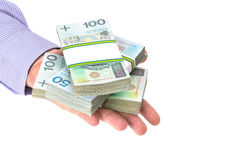 Cash in hand as a loan symbol. Over white background royalty free stock photos
