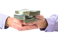 Cash in hand as a loan symbol. Over white background Royalty Free Stock Images