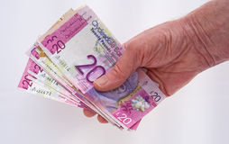 Cash in hand. Black economy.  Stock Photo