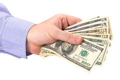 Cash in hand of businessman. Over white Stock Photo