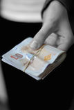 Cash in hand - giving money royalty free stock photo