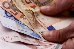 Cash in hands Royalty Free Stock Images