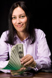 Cash in hands. Pretty caucasian girl holds cash in hands in casino Stock Photo