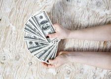Cash in hands Stock Photos