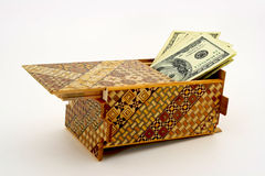 Cash hidden in a puzzle box Stock Images
