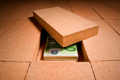 Cash in hiding place. Personal savings under a brick in the floor Royalty Free Stock Image