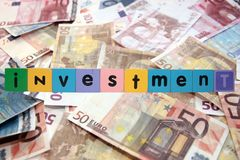 Cash house investment in toy letters stock image