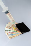 Cash injection. Wallet with money, a syringe injecting money into it Royalty Free Stock Photo