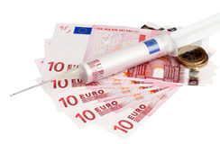 Cash injection of euros. Syringe containing euro bill representing health care costs or an injection of cash for savings or debt royalty free stock image