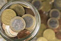 Cash Jar Filled with coins Royalty Free Stock Image
