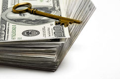Cash and Key for Wealth and Riches Royalty Free Stock Photography