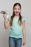 Cash and kid Stock Images
