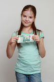 Cash and kid Stock Image