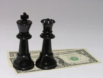 Cash is king #2. A black chess king and queen on a US$1 bill note Royalty Free Stock Photo
