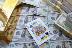 Cash Is King Concept With King Poker Card On Stacks Of Money With Gold Bar High Quality