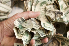 Cash Lift. A hand lifts a handful of money Stock Images