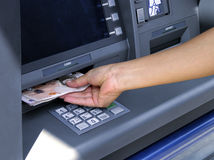 Cash Machine. Hand taking out cash from machine (British Pounds Stock Image