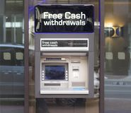 Cash machine ATM. Automated teller machine placed in a glass wall Stock Photo