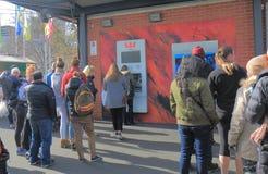 Cash machine ATM queue Melbourne Australia. People queue for ATM in Melbourne Australia Stock Image