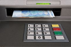 Cash machine with Euros - closeup Stock Photo