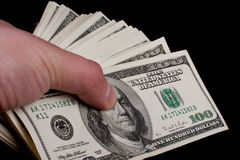 Cash in Male Hand. Isolated on black background Stock Photography
