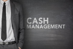 Cash management on blackboard Royalty Free Stock Image