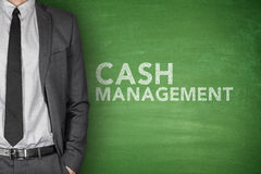 Cash management on blackboard. Cash management on black blackboard with businessman Royalty Free Stock Photos