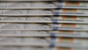 Cash money background. Benjamin Franklin portrait on 100 US dollar bill close up, stock video footage