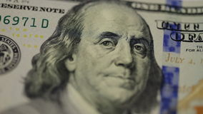 Cash money background. Benjamin Franklin portrait on 100 US dollar bill close up, the image is rotated. Cash money background. Benjamin Franklin portrait on 100 stock video