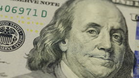 Cash money background. Benjamin Franklin portrait on 100 US dollar bill close up, the image is rotated. Cash money background. Benjamin Franklin portrait on 100 stock footage