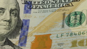Cash money background. Benjamin Franklin portrait on 100 US dollar bill close up, the image is rotated. Cash money background. Benjamin Franklin portrait on 100 stock video footage